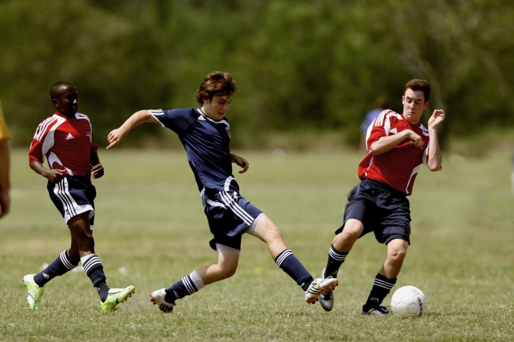 Guy Playing A Foot Ball (Can Overcome Loneliness)