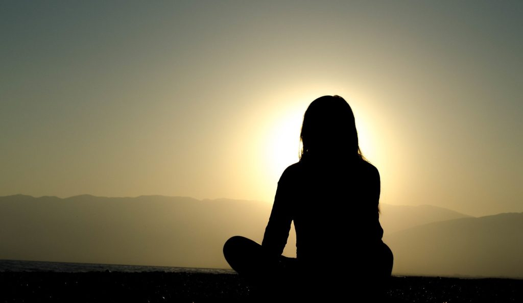 girl meditating to Overcome Depression
