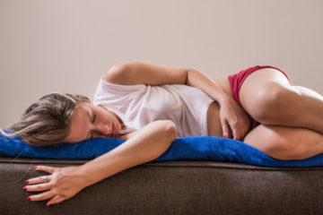 girl sleeping with gas pain