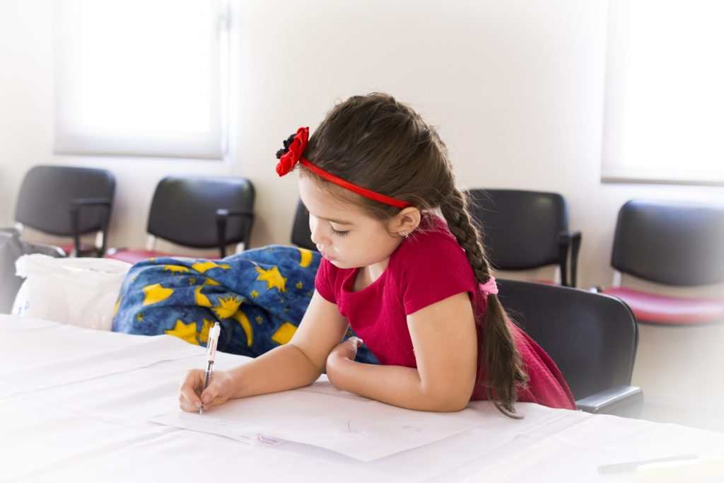 Child Writing Notes ( Suffers From Dyslexia)